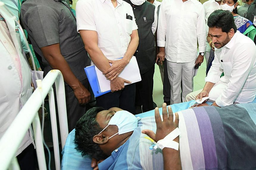 Andhra Pradesh Chief Minister YS Jagan Mohan Reddy (right) meets patients struck by the mystery illness.