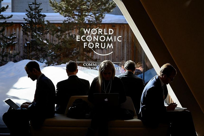 Some delegates at this year's World Economic Forum annual meeting in Davos, Switzerland, in January. The WEF Special Annual Meeting 2021 is set to be held in Singapore next May. It will be only the second time the meeting will take place outside of D