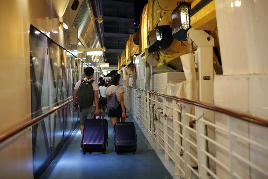 Passengers disembarking from the Quantum of the Seas, on Dec 9, 2020.