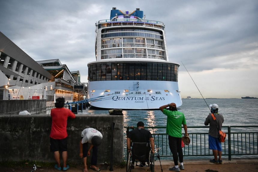The Royal Caribbean cruise ship Quantum of the Seas returned to Singapore after a passenger tested positive for Covid-19.