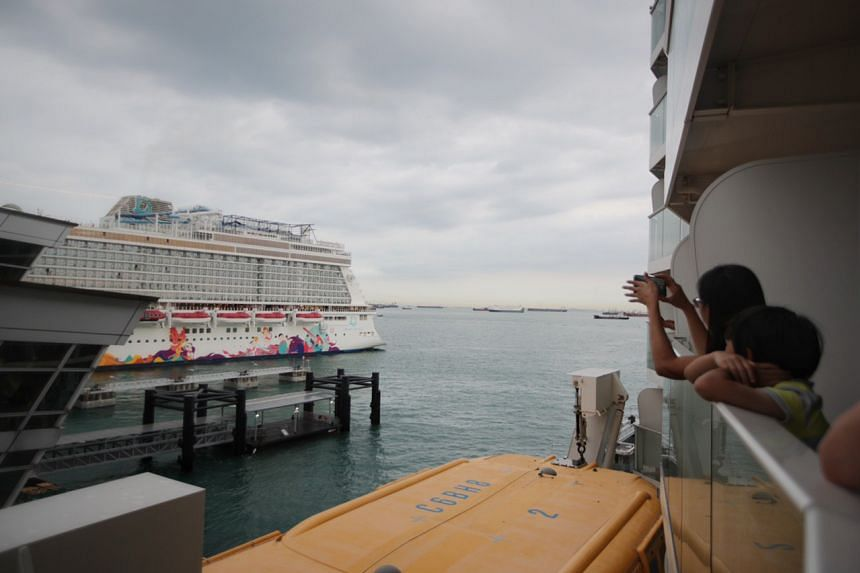 Dram Cruises' World Dream sets sail from the Marina Bay Cruise Centre as view from stateroom of Quantum of the Seas.