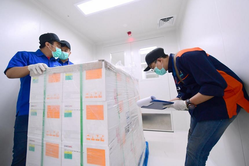 An official checks on Covid-19 vaccines as they arrive at PT Bio Farma (Persero) in the first shipment to Indonesia in Bandung.
