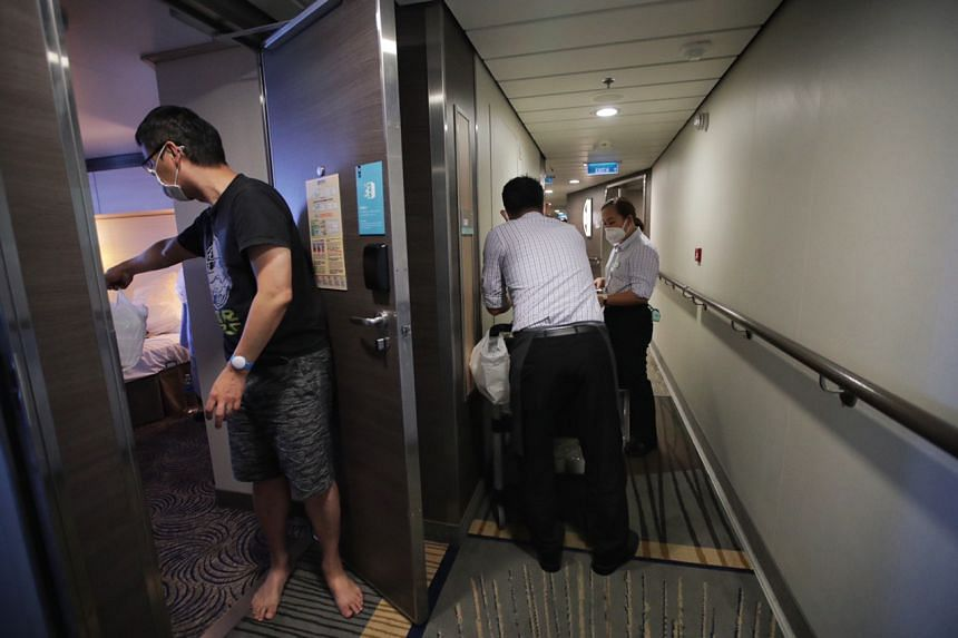 Quantum of the Seas cruise ship staff deliver lunch to passengers around noon on Dec 9, 2020.