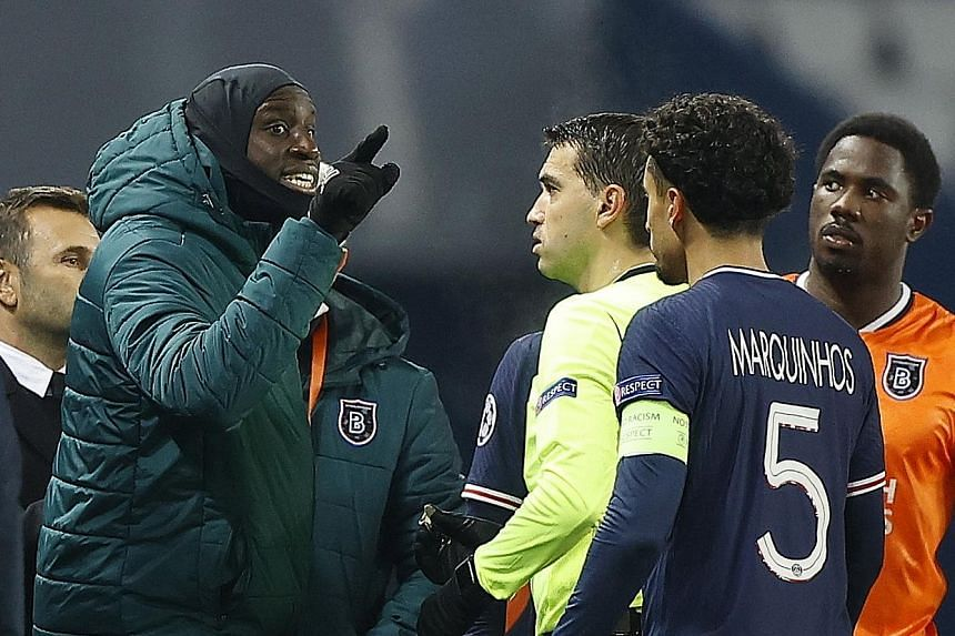 Basaksehir substitute Demba Ba remonstrating with referee Ovidiu Hategan after assistant coach Pierre Webo was allegedly abused by the fourth official in the Champions League game against PSG on Tuesday.