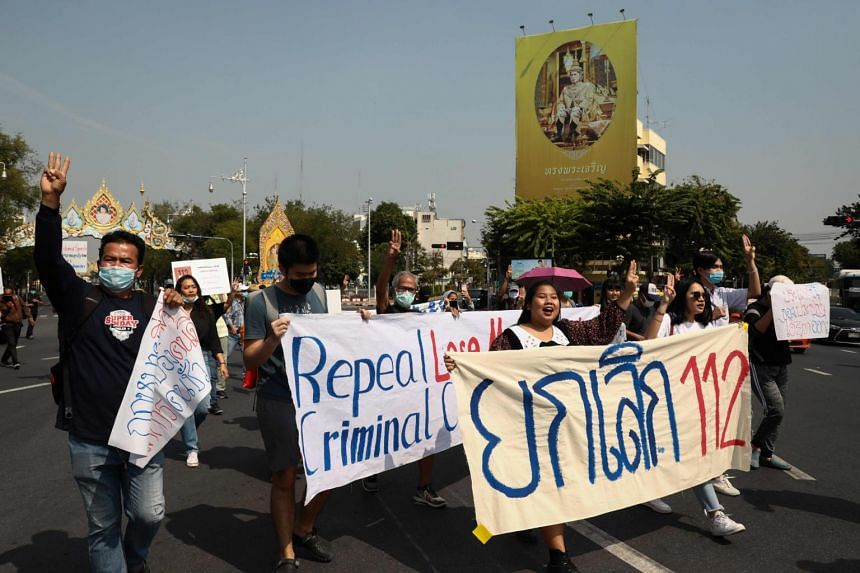 Pro-democracy protesters take part in a march to denounce the use of the lese majeste law, in Bangkok on Dec 10, 2020.