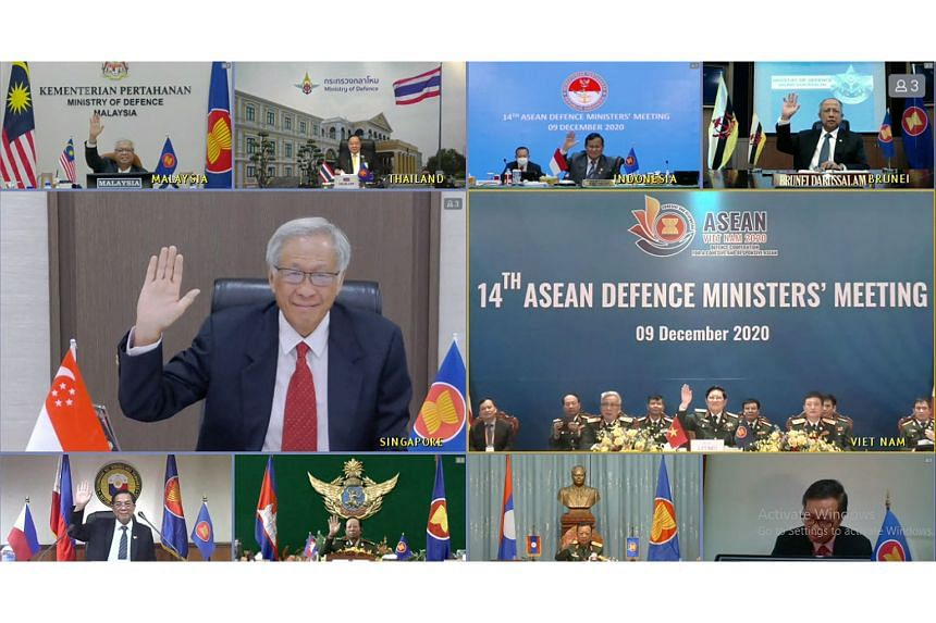 Singapore's Defence Minister Ng Eng Hen with other Asean defence ministers at the virtual 14th Asean Defence Ministers' Meeting yesterday. They exchanged views on the impact of Covid-19 on the region in the past year. PHOTO: MINDEF