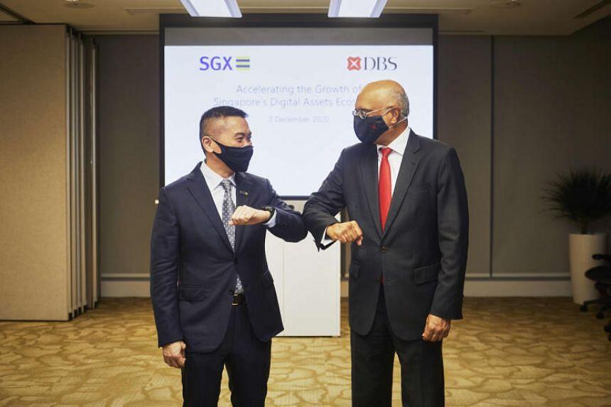 Chief executive of Singapore Exchange Loh Boon Chye (left) and DBS chief executive Piyush Gupta.