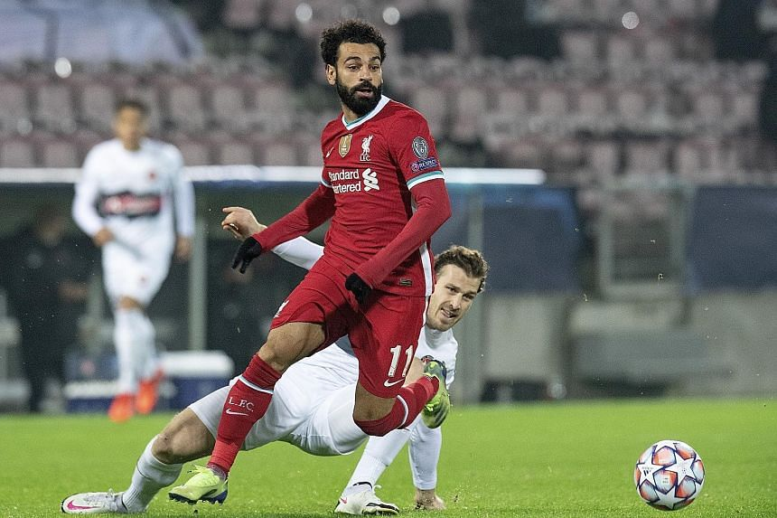 Liverpool's Mohamed Salah battling for the ball with Midtjylland's Erik Sviatchenko in their 1-1 Champions League draw on Wednesday. Salah, who scored for the Reds, has 22 Champions League goals, surpassing former captain Steven Gerrard's tally.