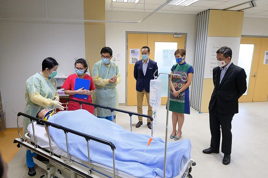 (From right) Trade and Industry Minister Chan Chun Sing, Manpower Minister Josephine Teo and Senior Minister of State for Health Koh Poh Koon observing a class undergoing training at the National University of Singapore's Alice Lee Centre for Nursing