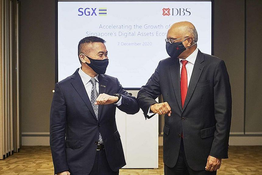 SGX chief executive Loh Boon Chye (left) and DBS chief executive Piyush Gupta. SGX will take a 10 per cent stake in the DBS Digital Exchange. PHOTO: DBS