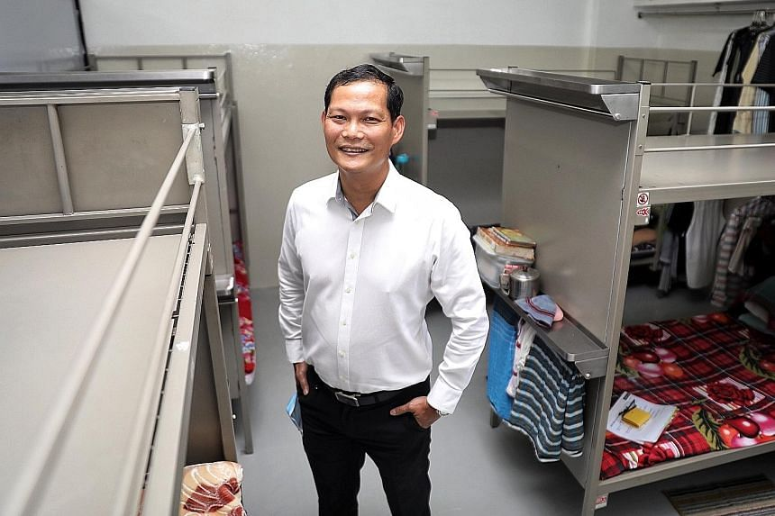 Mr Tung Yui Fai, chief of the Assurance, Care and Engagement (Ace) Group under the Ministry Of Manpower, at Chye Heng Huat Engineering's factory-converted dormitory yesterday. Ace Group is working with its partners on the issue of new housing standar