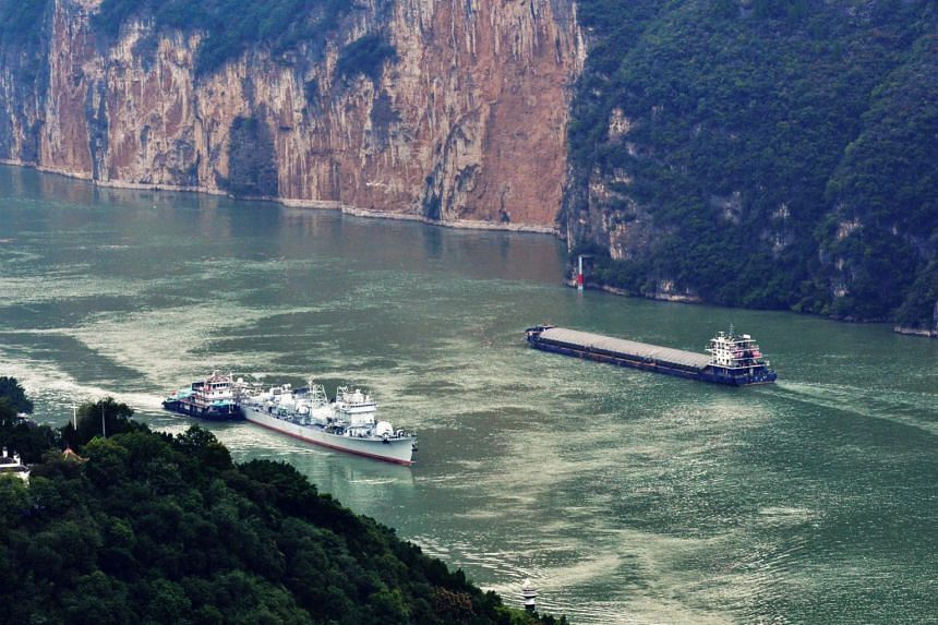 The dam under construction will have the potential to generate hydropower three times that of China's Three Gorges dam (above).