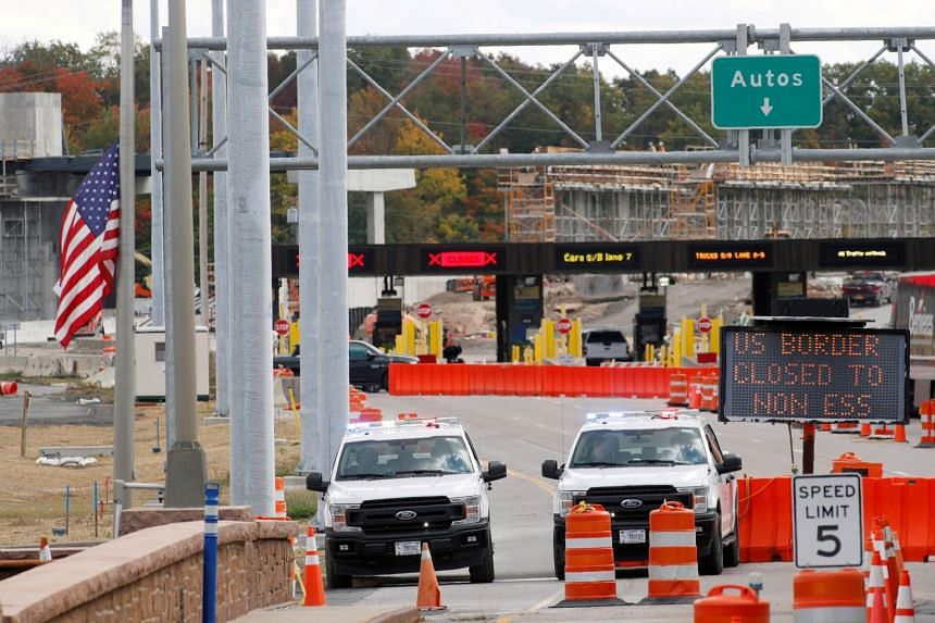 A September 2020 photo shows the US-Canada border closed to non-essential traffic.