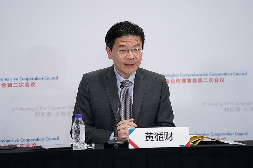 Education Minister and Second Minister for Finance Lawrence Wong speaking at the second Singapore-Shanghai Comprehensive Cooperation Council meeting that was held virtually yesterday.