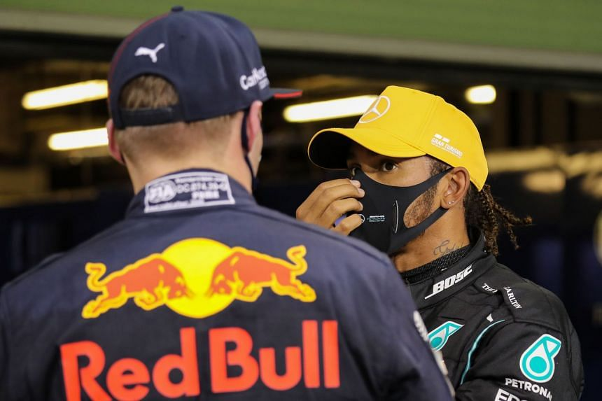Hamilton (right) and Red Bull's Dutch driver Max Verstappen chat after the qualifying session.