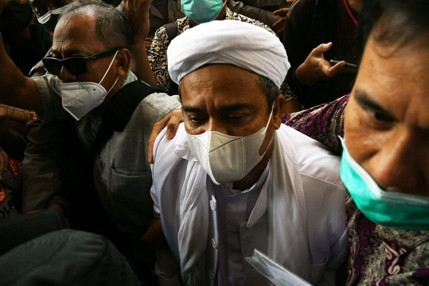 Indonesian Islamic cleric Rizieq Shihab arrives at the police headquarters in Jakarta on Dec 12, 2020.