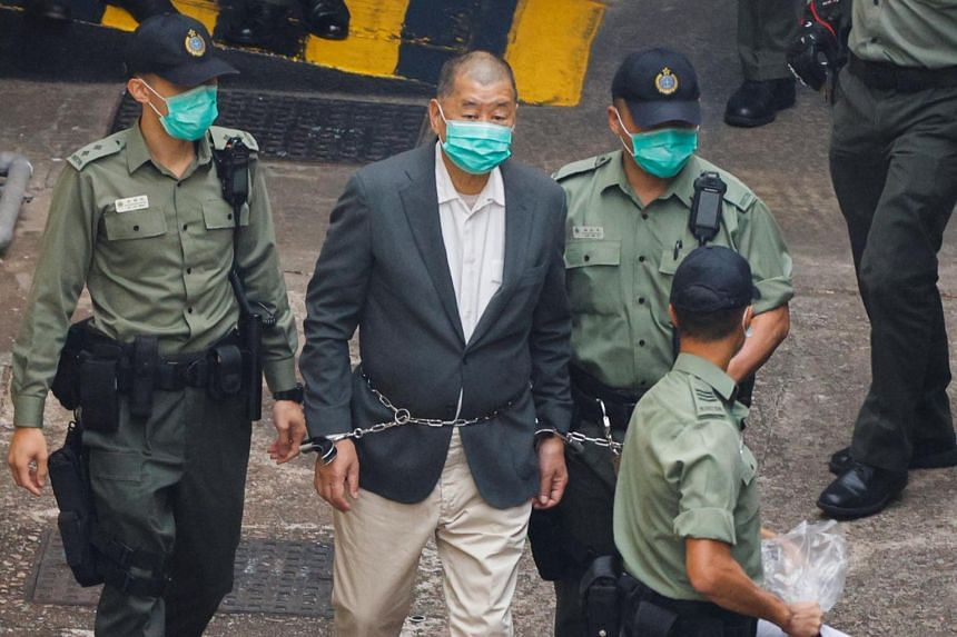 Media mogul Jimmy Lai heads to court after being charged under the national security law in Hong Kong on Dec 12, 2020.