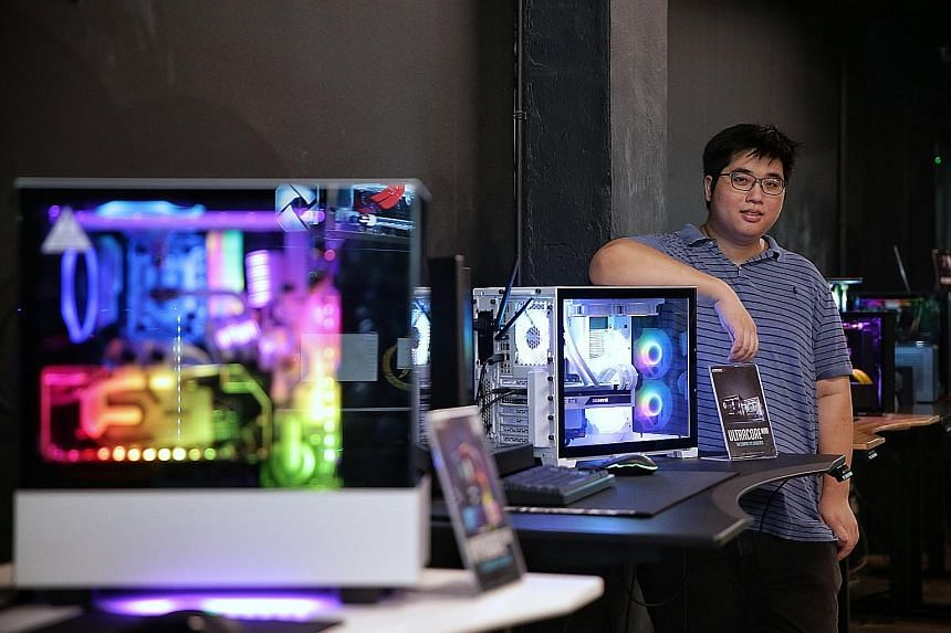 Mr Marcus Wee (above) and his twin brother Joe Wee run Aftershock, Singapore's biggest boutique PC builder. Already with operations in Malaysia and Australia, it is looking to expand to two more countries in the next year.