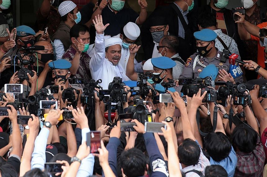The police yesterday arrested firebrand cleric Rizieq Shihab (above) for allegedly flouting Covid-19 restrictions by holding events that attracted thousands of attendees in Jakarta.