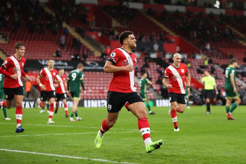 Che Adams celebrates scoring their first goal at Saint Mary's Stadium, in Southampton, Britain, on Dec 13, 2020.