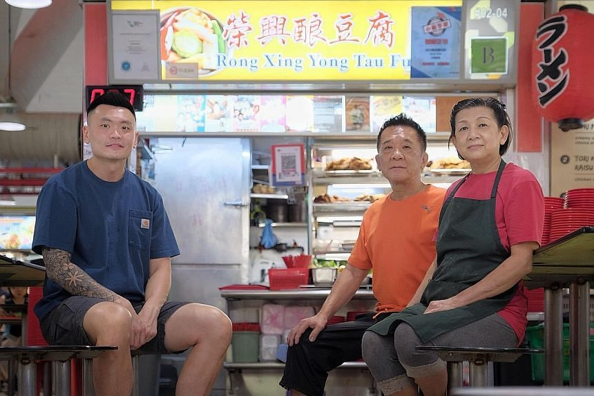 (From left) Clement Wang at Rong Xing Yong Tau Fu stall in Tanjong Pagar with owners Foo Soo Lim and Tee Chun Moy.