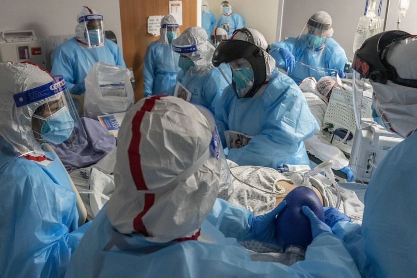 Doctors perform an intubation procedure on a Covid-19 patient at a Texas medical centre on Dec 11, 2020.