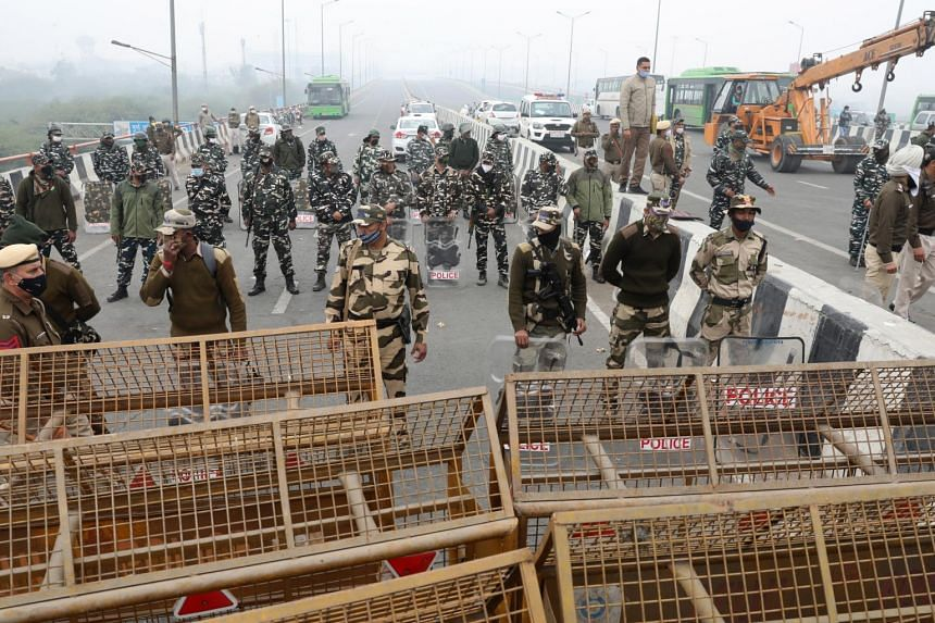 Local authorities put up barricades to prevent farmers from entering New Delhi in large numbers.