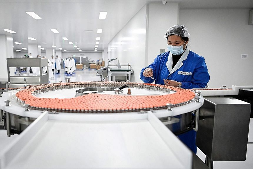 A worker at biopharmaceutical company Sinovac Biotech's Beijing factory in September. About a fifth of all shots listed by the World Health Organisation as undergoing clinical trials are Chinese in origin.