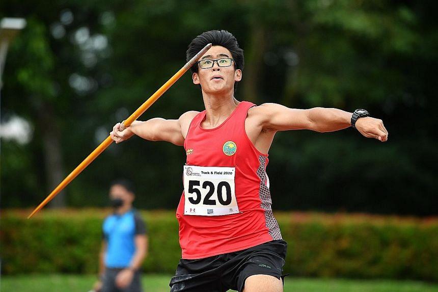 Roy Ng, 17, setting an Under-18 boys' national javelin record with a 61.79m throw at Kallang yesterday. ST PHOTO: CHONG JUN LIANG