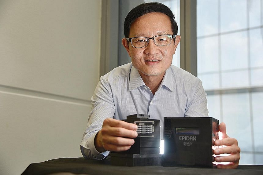 Professor Lim Chwee Teck with the portable polymerase chain reaction kit called Epidax. ST PHOTO: DESMOND WEE