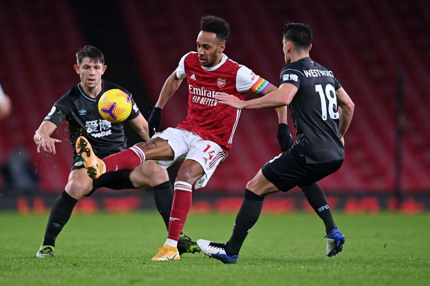 Arsenal's Pierre-Emerick Aubameyang (centre) controls the ball during the game against Burnley.