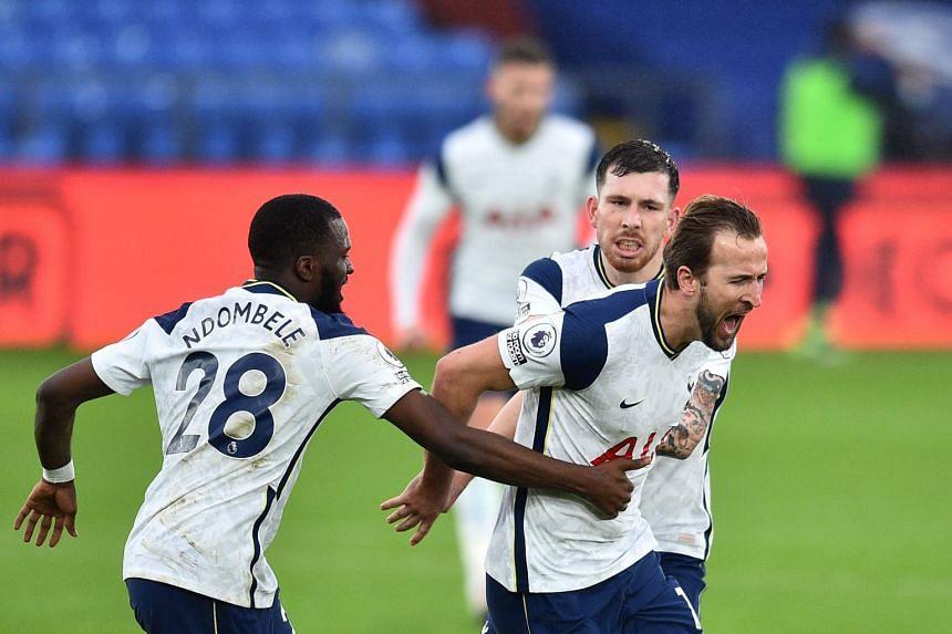 Tottenham Hotspur striker Harry Kane (right) celebrates scoring the opening goal with teammates on Dec 13, 2020.