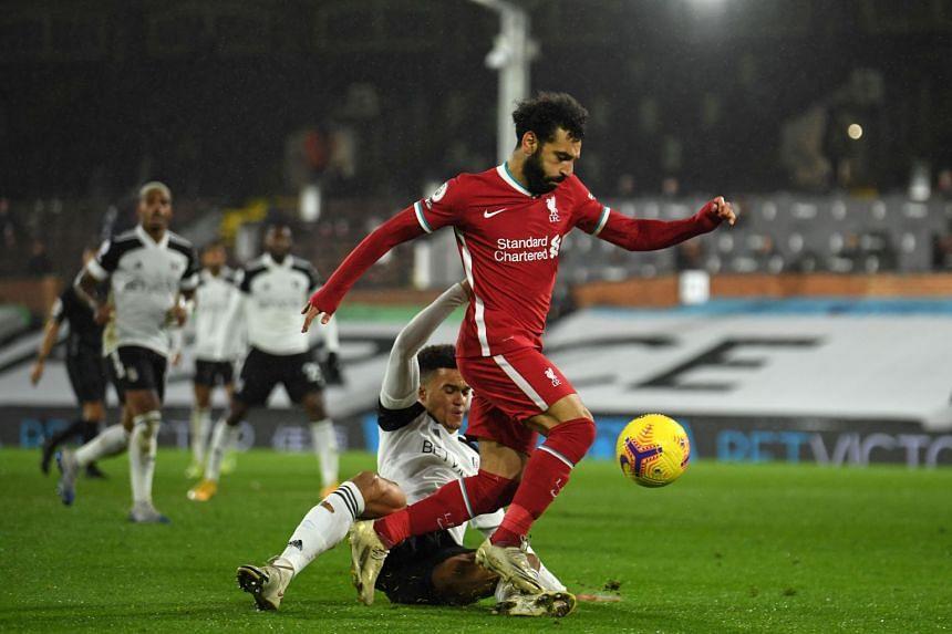 Liverpool midfielder Mohamed Salah (right) in action against Fulham's Antonee Robinson on Dec 13, 2020.