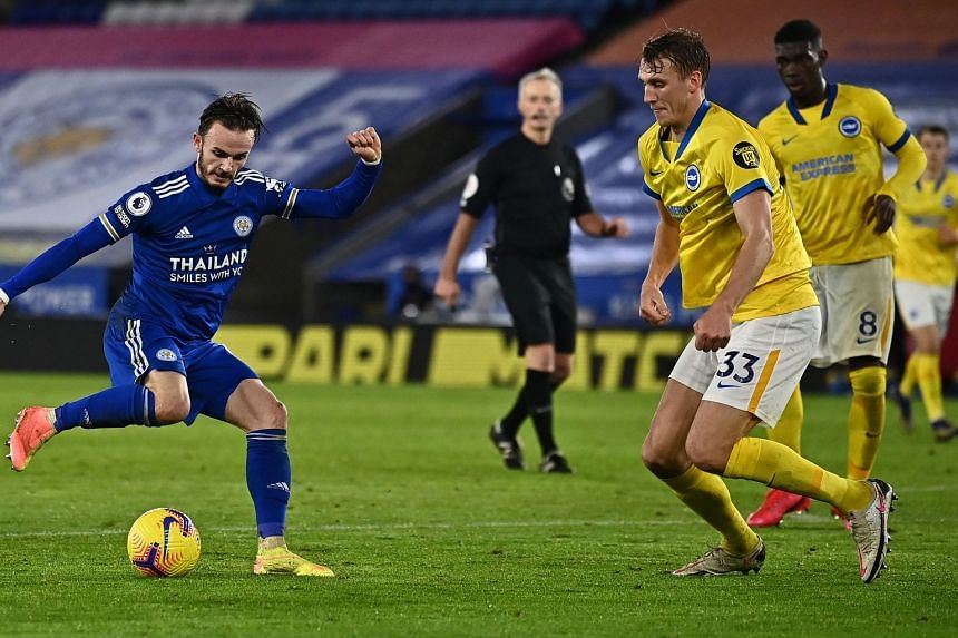 Leicester City's James Maddison (left) controls the ball before scoring the third goal against Brighton.