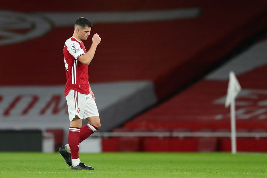 Arsenal's Granit Xhaka looks dejected after being sent off during the match on Dec 13, 2020.