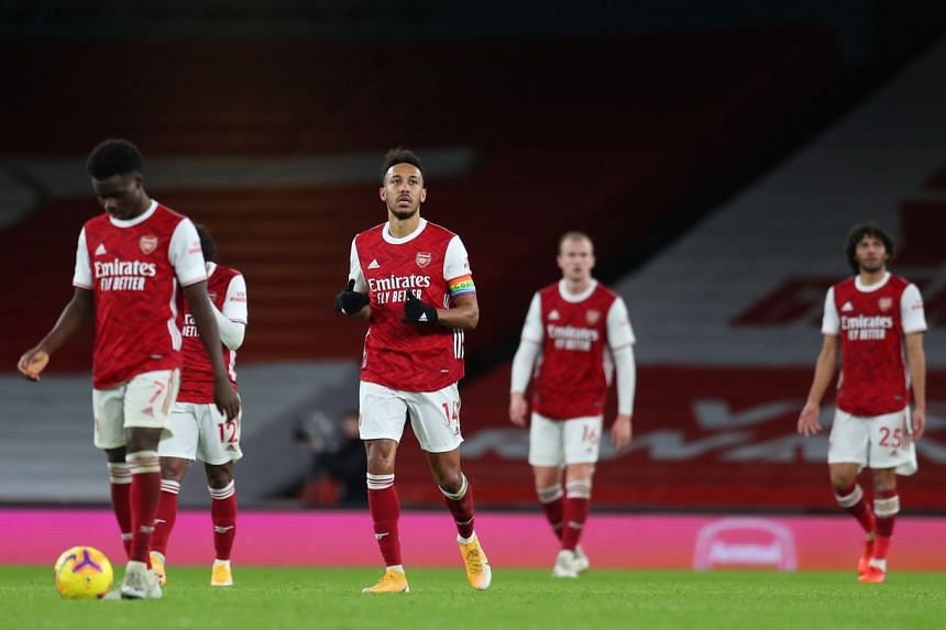 Arsenal's Pierre-Emerick Aubameyang (second from left) looks dejected after scoring an own goal on Dec 13, 2020.