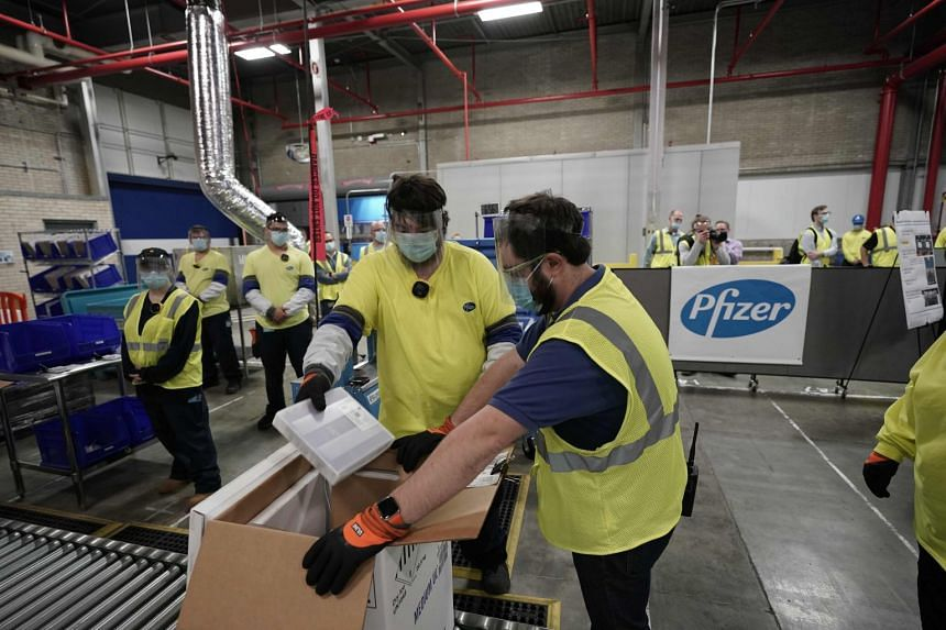 Boxes containing the Pfizer-BioNTech Covid-19 vaccine are prepared to be shipped at the Pfizer Global Supply Kalamazoo manufacturing plant in Michigan on Dec 13, 2020.