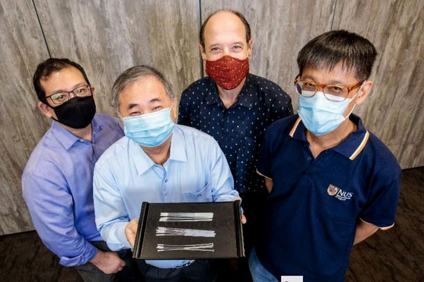 National University of Singapore deputy president (innovation and enterprise) Professor Freddy Boey with the swabs. With him are (from left) Dr Alfred Chia, Associate Professor David Allen and Associate Professor Yen Ching-Chiuan.