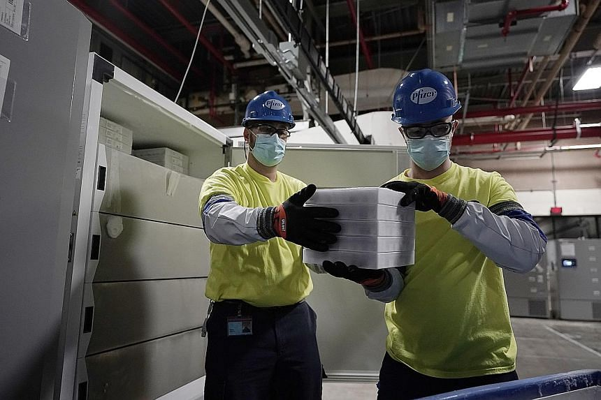 Workers preparing boxes containing the Pfizer-BioNTech Covid-19 vaccine for shipment at the Pfizer global supply facility in Kalamazoo, Michigan, in the United States, on Sunday. In Singapore, those who are at greatest risk will be given first priori
