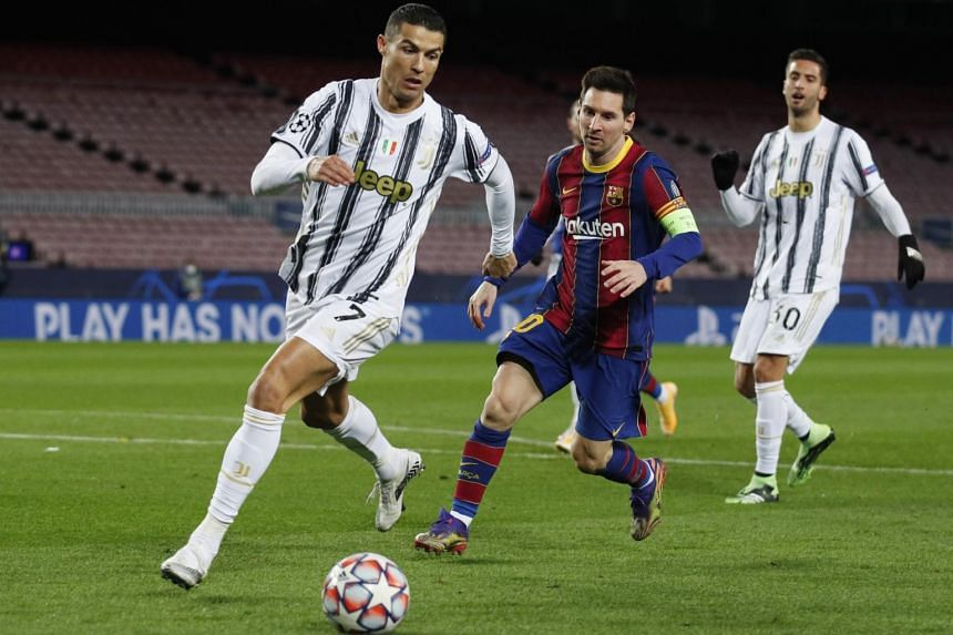 Barcelona's Lionel Messi in action with Juventus' Cristiano Ronaldo at Camp Nou on Dec 8, 2020.
