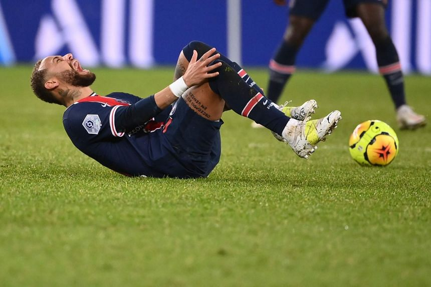 PSG's Neymar reacts after getting tackled during the French L1 football match against Lyon, on Dec 13, 2020.