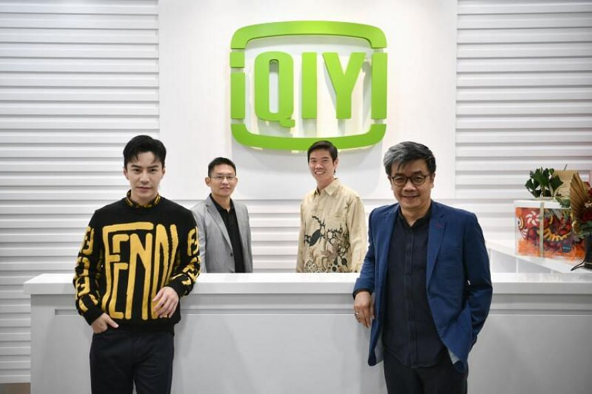 (From left) iQiyi ambassador Lawrence Wong, iQiyi's vice-president of sales Frankie Fu, iQiyi's vice-president of international business Kuek Yu-Chuang, and assistant chief executive for media and innovation at IMDA Howie Lau.