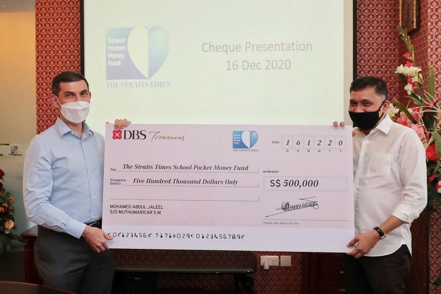 ST School Pocket Money Fund chairman Warren Fernandez (left) and Mini Environment Service Group founder and chief executive Mohamed Abdul Jaleel.