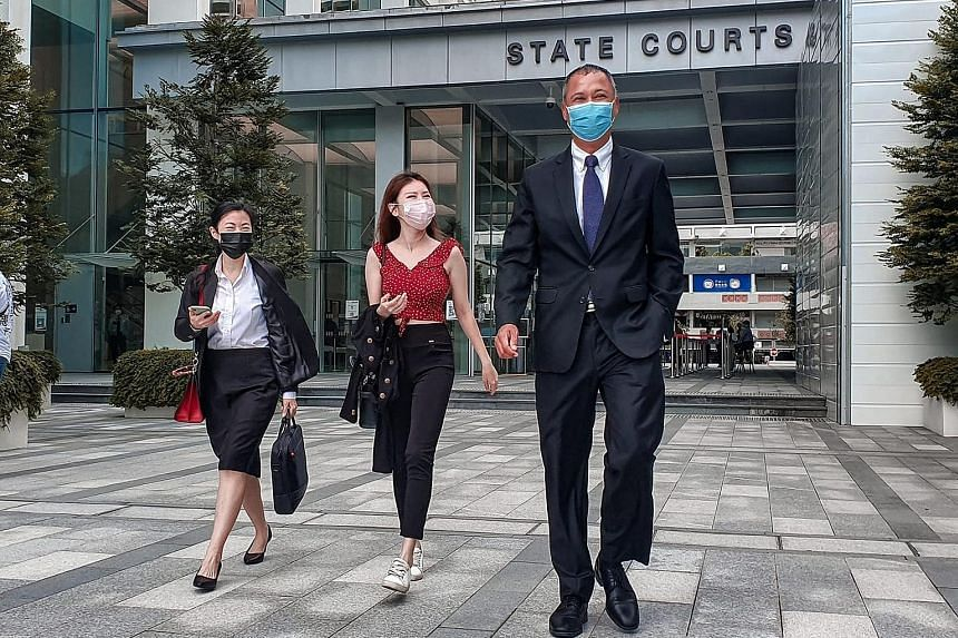Blogger Vaune Phan (centre), flanked by her lawyers Cherisse Foo and Suresh Divyanathan, on Tuesday. After a trial, the court found that the social media personality had been defamed by Mr Mark Yeow last year.