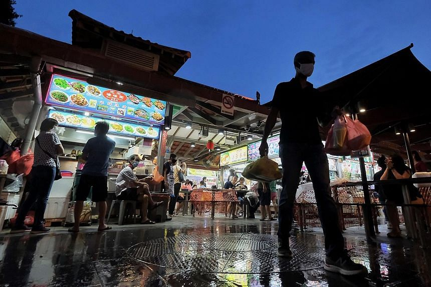 Customers at Chomp Chomp Food Centre in Serangoon Gardens yesterday. The inscription of Singapore's hawker culture on the Unesco intangible heritage list has been anticipated for nearly three years. Singapore Heritage Society president Jack Lee said