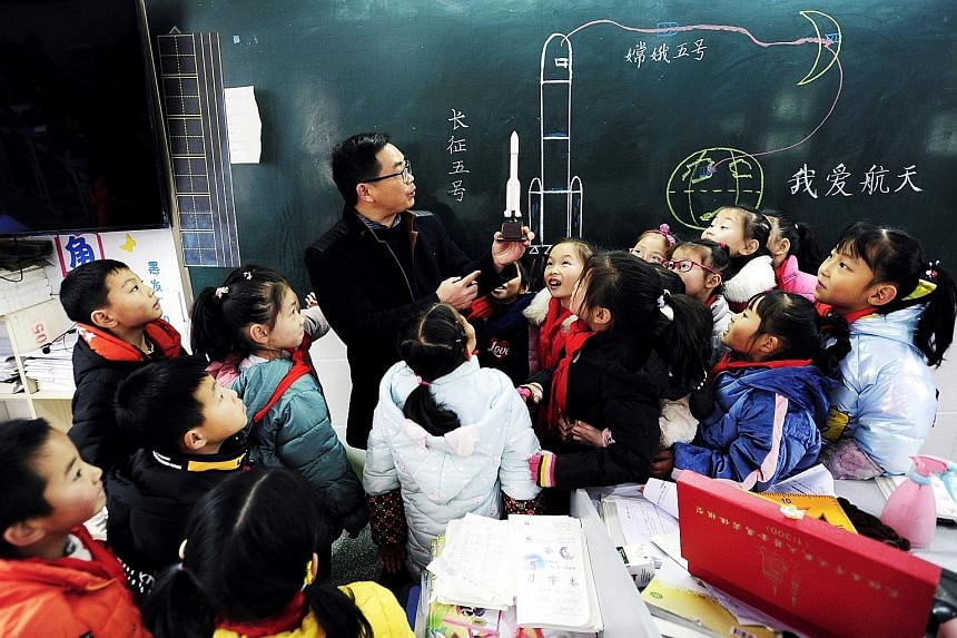 China's Ministry of Education said that during its ongoing curriculum revision launched early last year for compulsory education - first grade to ninth - it decided to include coding in IT courses. PHOTO: AGENCE FRANCE-PRESSE