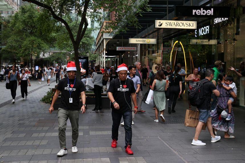 People walking in a shopping plaza in Sydney on Dec 17, 2020.