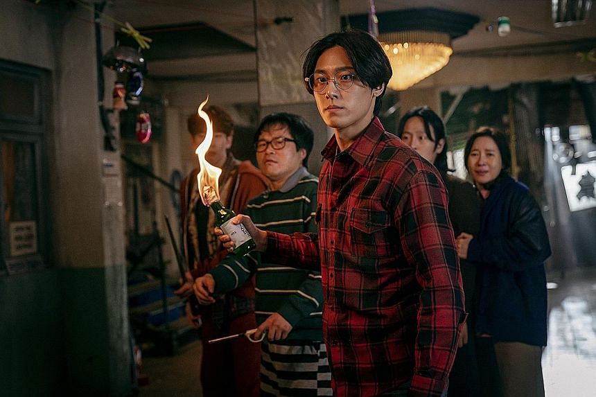 Lee Do-hyun (centre) plays a young medical student in Sweet Home.