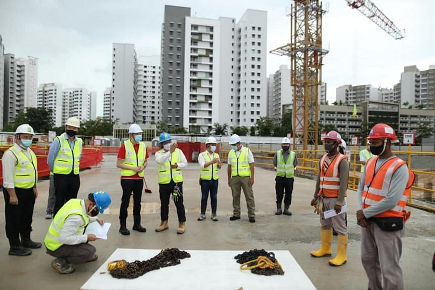 Labour MP Melvin Yong (in red top) visited the Straits Construction Singapore site in Tampines on Dec 18, 2020.