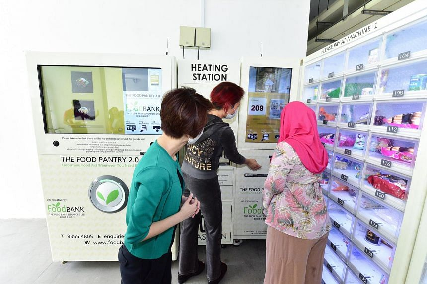 South West District Mayor Low Yen Ling (left) at the launch of the vending machine.